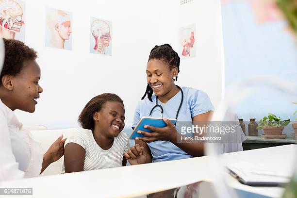 Doctor Explaining Test Results To Her Patient