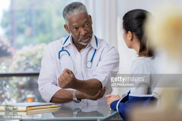 Doctor explains injury to patient