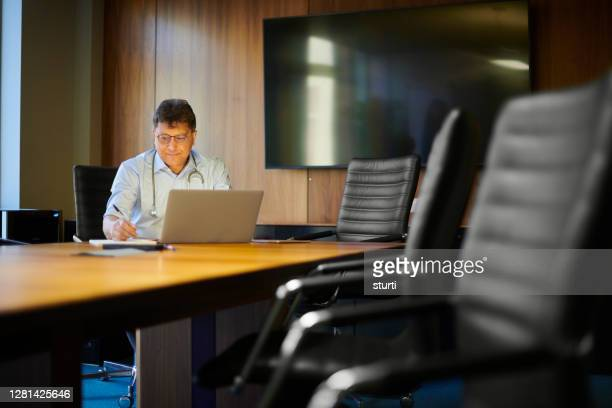 doctor filling out paperwork - legal system stock pictures, royalty-free photos & images