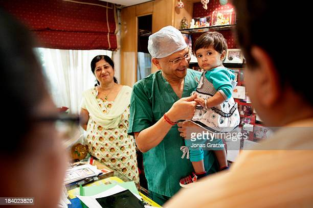 CALLED 'DELHI IVF' NEW DELHI INDIA A doctor from a clinic located in New Delhi called 'Delhi IVF' holds up a baby that he has helped to develop Eggs...