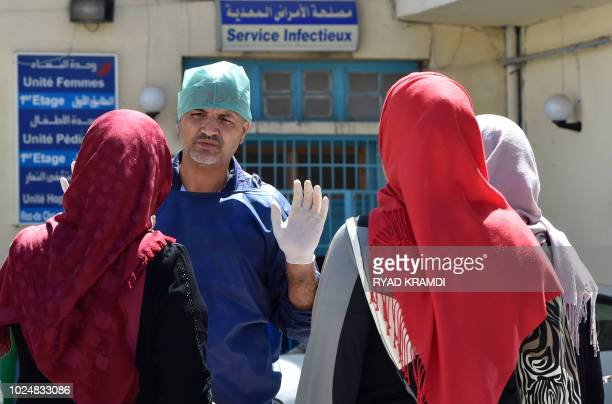 A doctor gestures outside a hospital in the Algerian town of Boufarik as the country faces a cholera outbreak on August 28 2018