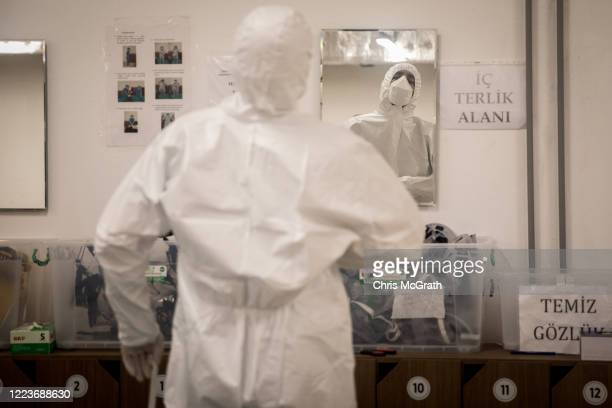Doctor gets dressed in personal protective equipment before assisting COVID-19 patients in the Kartal Dr. Lutii Kirdar Education and Research...