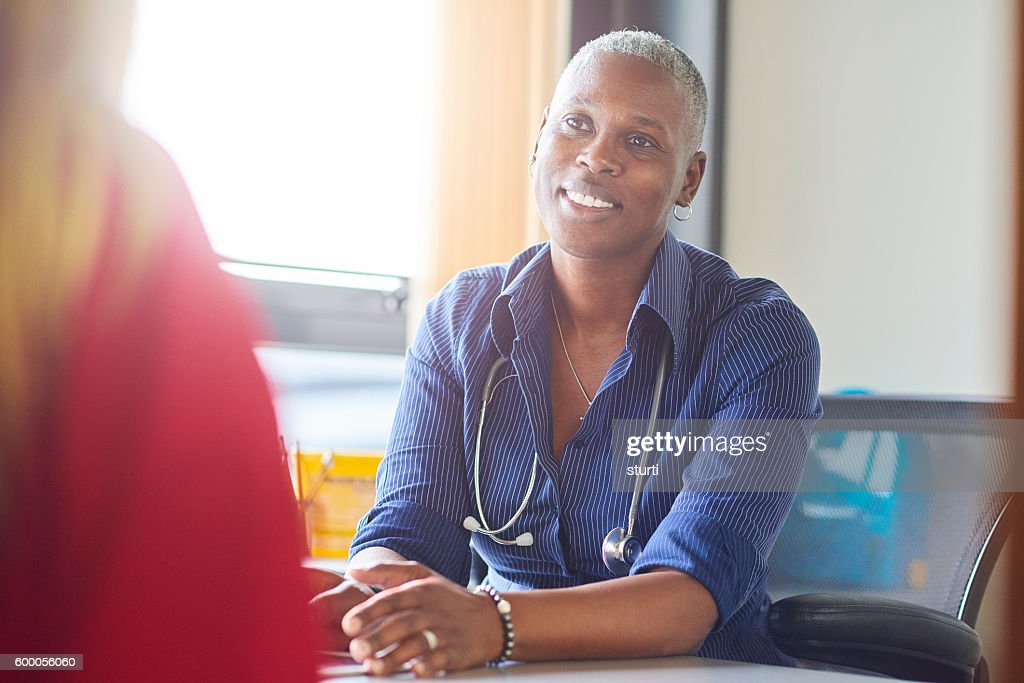 Doctor gives the all clear : Stock Photo