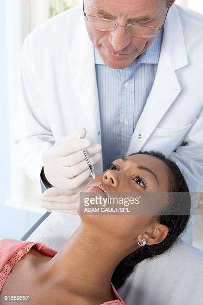 Doctor giving Botox treatment to patient