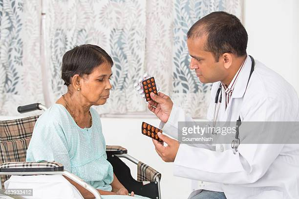 Doctor giving medicine to senior woman at a clinic