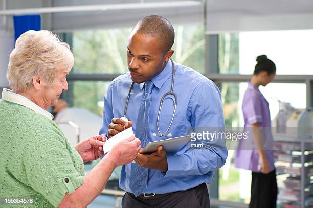doctor giving prescription advice - outpatient care stock pictures, royalty-free photos & images