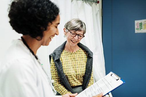 Doctor Going Over Test Results With Patient - gettyimageskorea