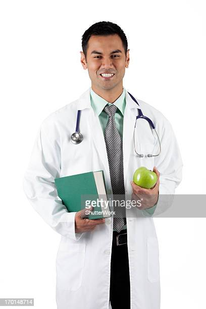 doctor green - handsome pakistani men stock photos and pictures