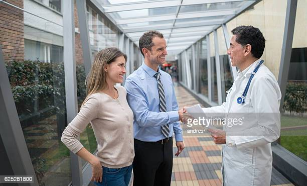 Doctor greeting patients at the hospital