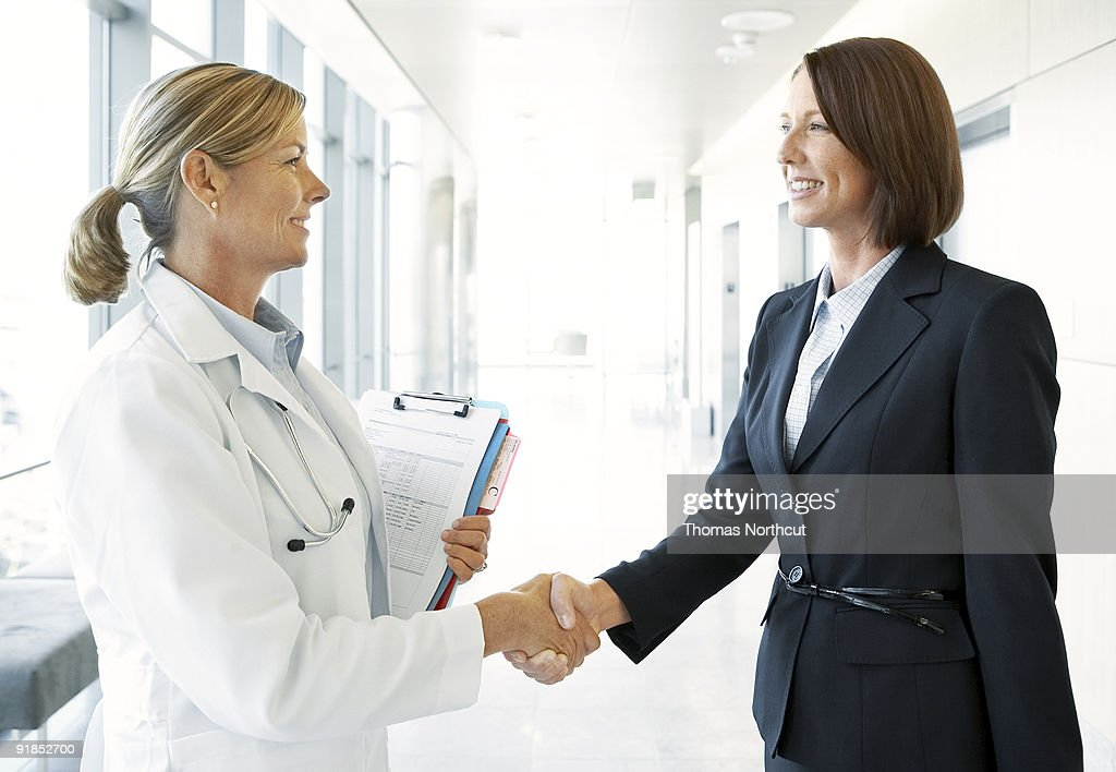 Doctor Greeting Pharmaceutical Rep In Lobby Stock Photo Getty Images