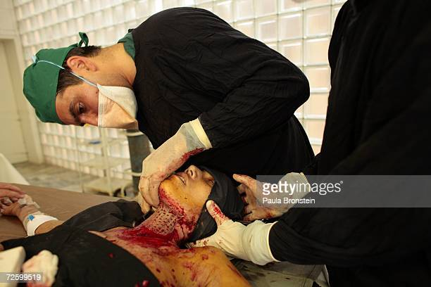 Doctor Hamayun Azizi performs a skin graft operation on Panwasha a self immolation victim at the Herat Regional hospital November 15 2006 in Herat...