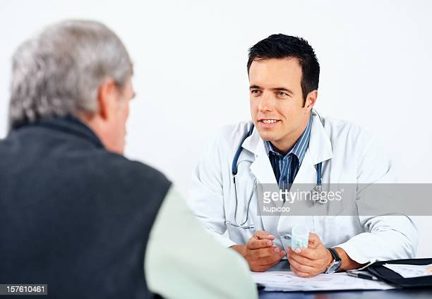 Doctor having a health conversation with senior patient