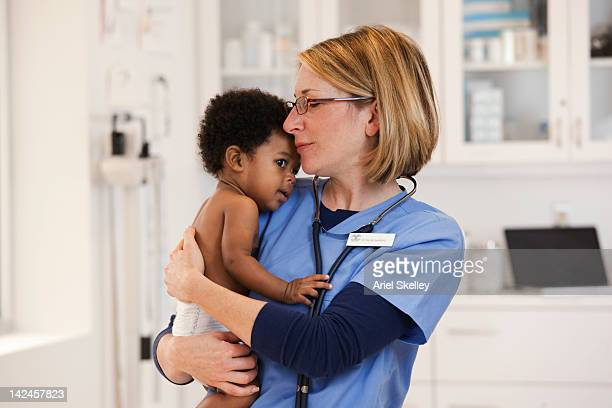 Doctor holding baby boy