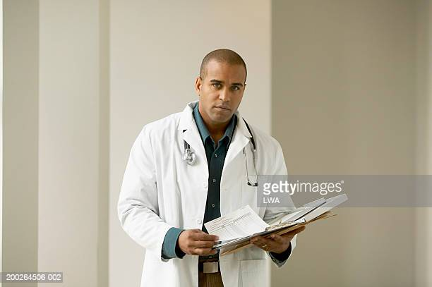 doctor holding chart, portrait - part of a series stock pictures, royalty-free photos & images