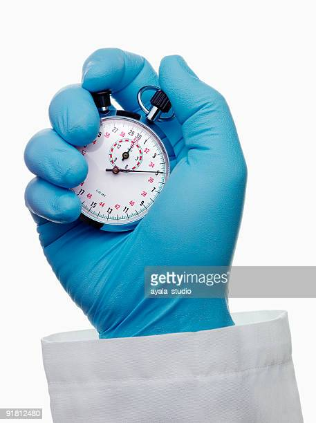 Doctor Holding Chronometer