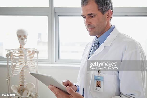 Doctor holding digital tablet in office