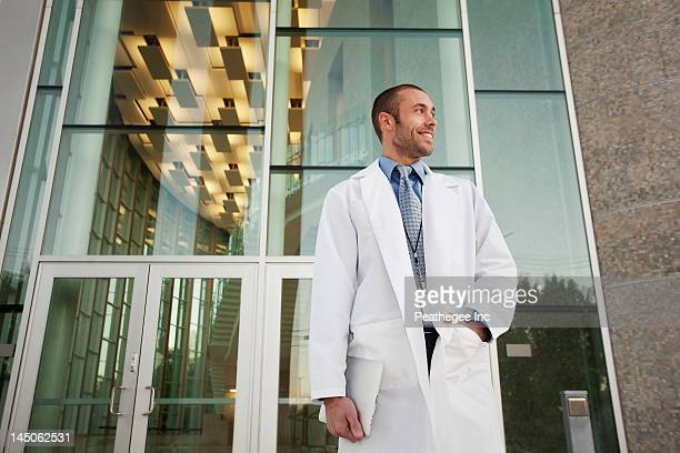 Doctor holding digital tablet outdoors