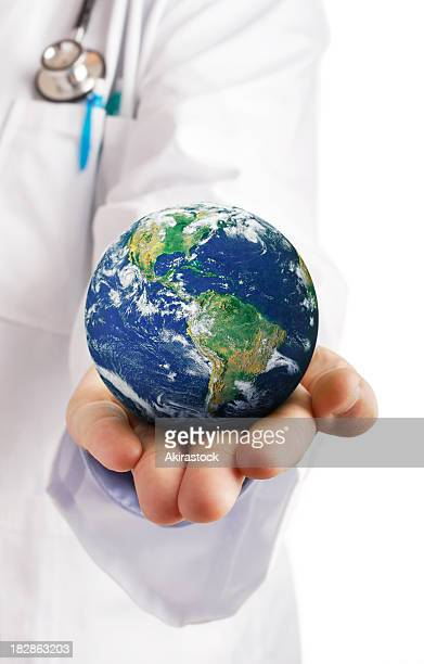 Doctor holding globe in their palm