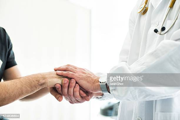 Doctor Holding Patient's Hands
