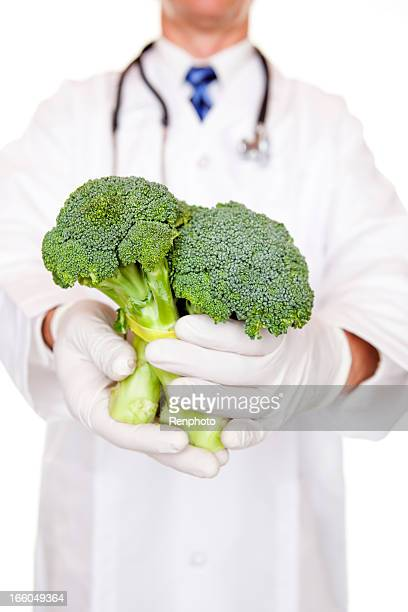 Doctor Holding Raw Broccoli