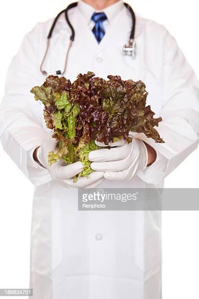 Doctor Holding Red-Tip Leaf Lettuce