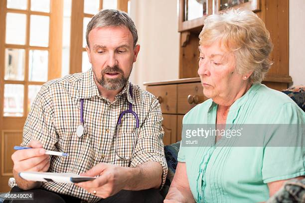 doctor home visit prescription - hospice stock pictures, royalty-free photos & images