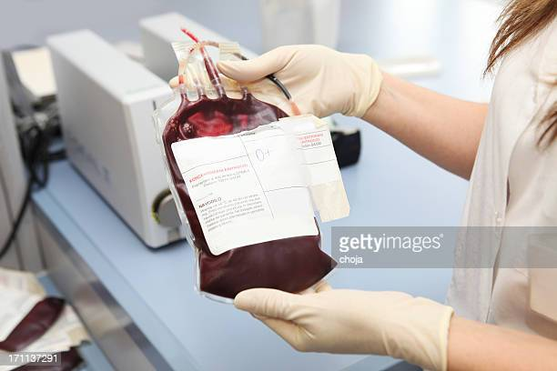 Doctor in a blood bank holding  bag  with red cells