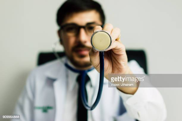 Doctor in a lab coat holding a stethoscope