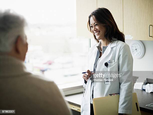 Doctor in discussion with mature female patient