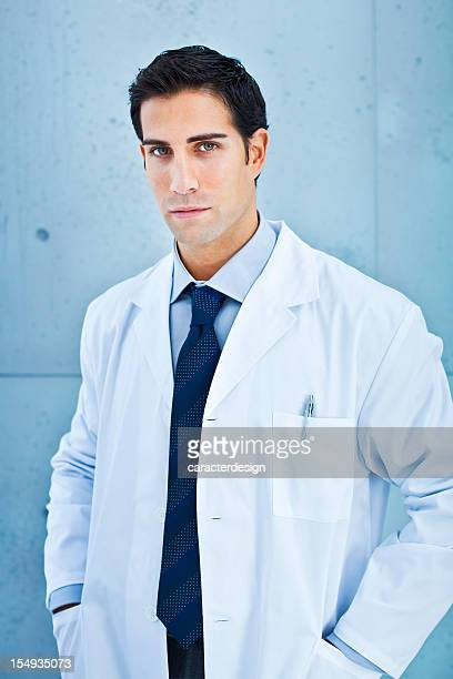 doctor in lab coat - hands in pockets stock pictures, royalty-free photos & images