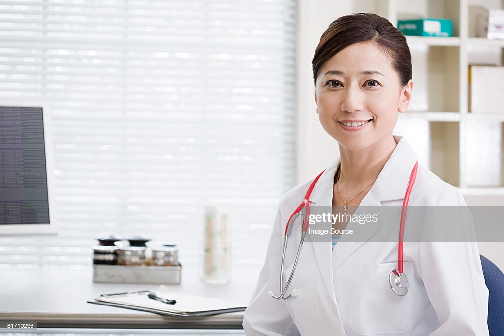 Doctor in office : Stock Photo