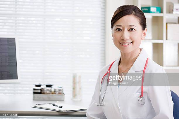 doctor in office - female doctor stock photos and pictures