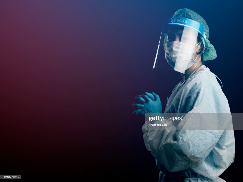 doctor in PPE suit uniform has stress and pray in Coronavirus outbreak or Covid-19, Concept of Covid-19 quarantine.Emotional stress of overworked doctor and medical care team during covid-10 period. : Stock Photo