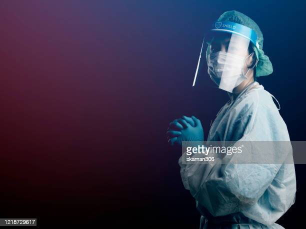 doctor in ppe suit uniform has stress and pray in coronavirus outbreak or covid-19, concept of covid-19 quarantine.emotional stress of overworked doctor and medical care team during covid-10 period. - infectious disease stock pictures, royalty-free photos & images