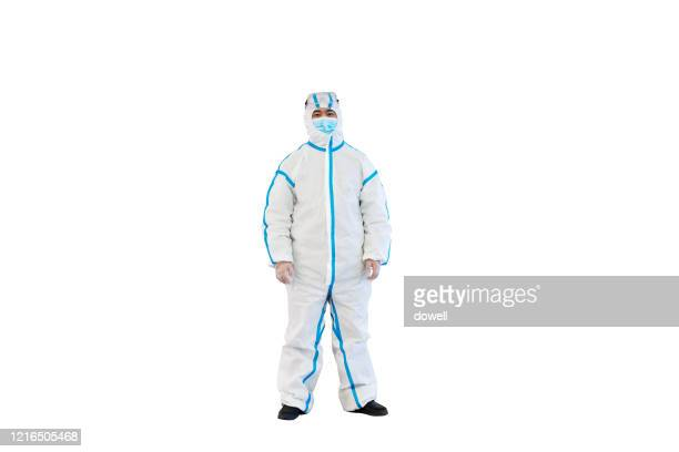 doctor in  protective suit with mask - protective suit stock pictures, royalty-free photos & images