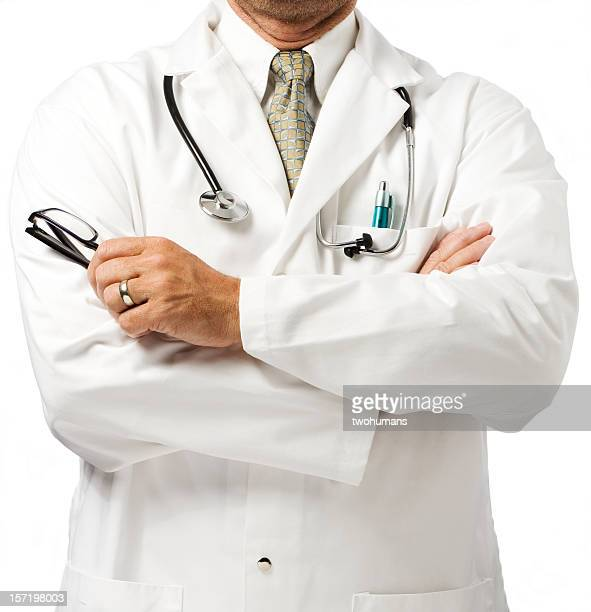 Doctor in white coat with folded arms