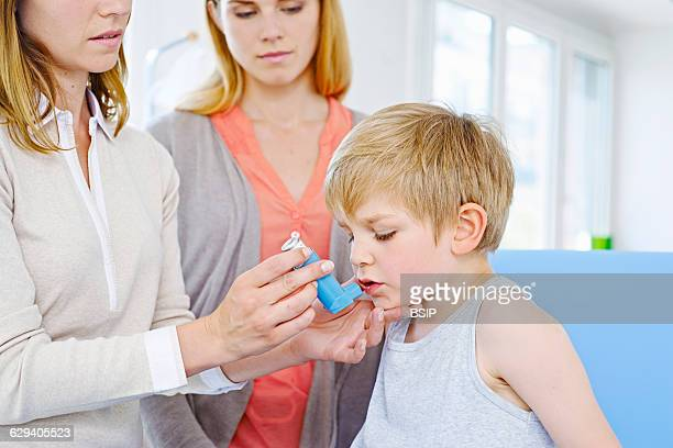 Doctor informing a mother about the use of a bronchodilator