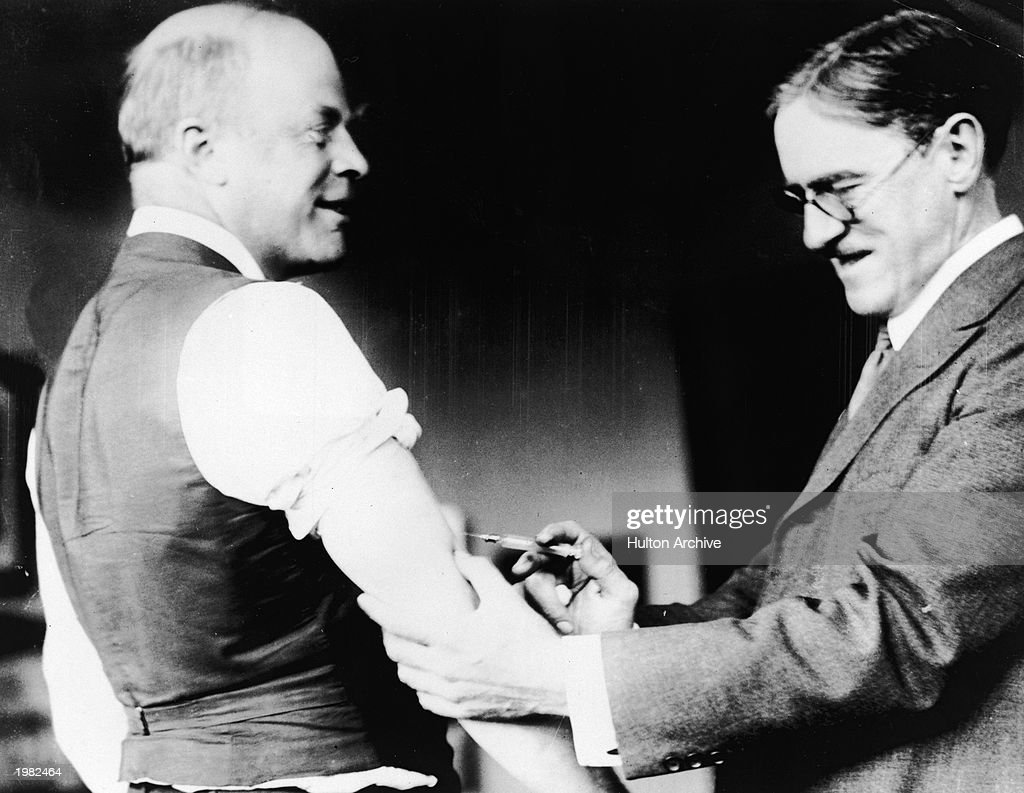 A doctor innoculates Major Peters of Boston against the Spanish Influenza virus during the epidemic, c. 1918.