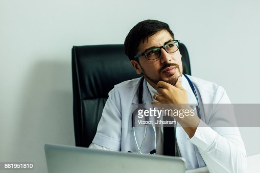 Doctor Is Working With Laptop In His Medical Office Stock Photo ...
