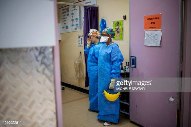 Doctor Jana du Plessis and Doctor Anele Mtanjana stand at the entrance of a resuscitation area where an intubox for worker safety designed is stored...