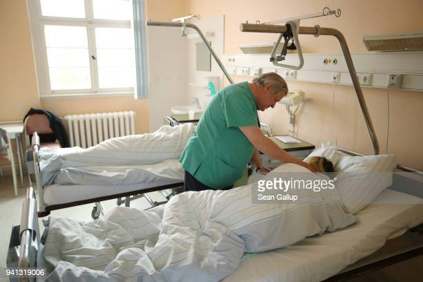 Doctor Janusz Rudzinski speaks to two women from Poland awaking from anesthesia after they underwent abortions at the Krankenhaus Prenzlau hospital...
