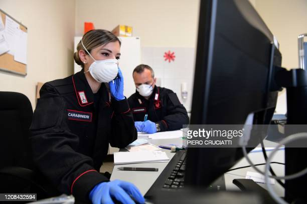 Doctor Jole Serra and nurse Salvatore Sacco of the Carabinieri Police, provide phone support to patients from the office of ATS Bergamo which...