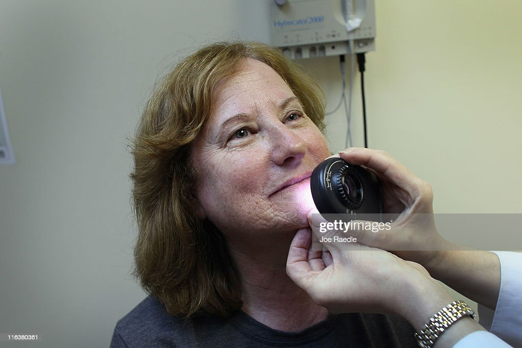 Doctor Jonette Keri, Dermatologist University of Miami School of Medicine, uses a dermatoscope as she examines Marcia Spevak Breiter for symptoms of skin cancer due to sun exposure on June 15, 2011 in Miami, Florida. The federal Food and Drug Administration announced that sunscreen manufacturers are to change the labels on their products to prohibit the use of certain marketing terms. The new rules are meant to help clear up confusion about the meaning of 'sun protection factor,' or SPF, and other terms like 'waterproof.'