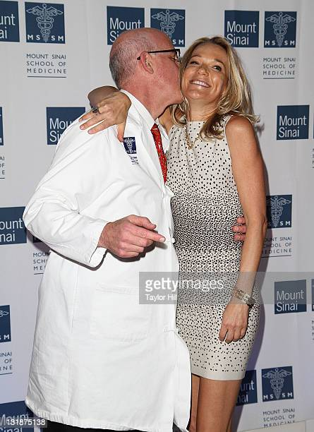 A doctor kisses Dr Eva AnderssonDubin on the cheek at the opening of Dubin Breast Center at the Tisch Cancer Institute at Mount Sinai Hospital on...