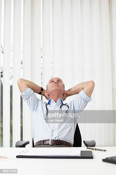 Doctor leaning back on a chair