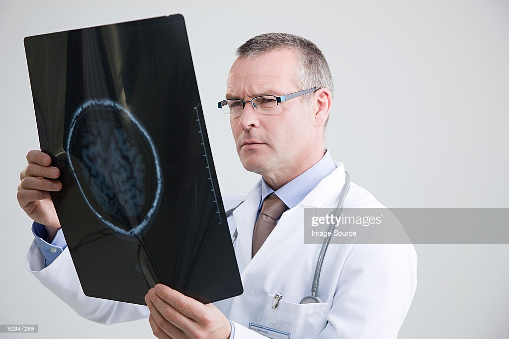 Doctor looking at mri scan : Stock Photo