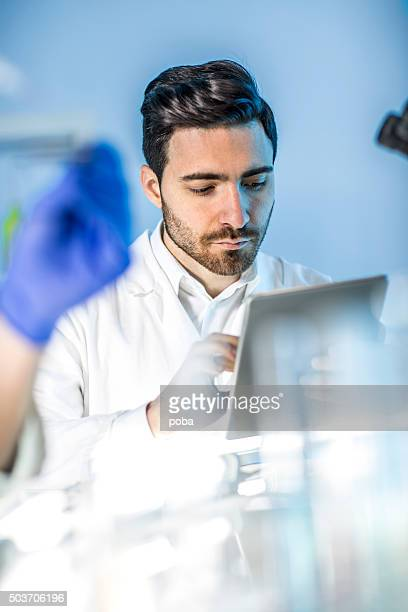 doctor looking   findings on a tablet in the lab