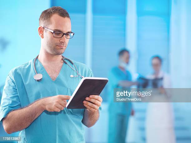 doctor looking on digital tablet