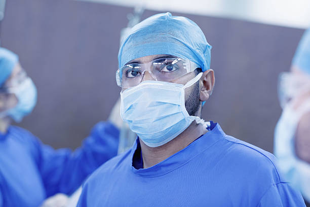 Doctor looking upward to monitor in hospital operating room