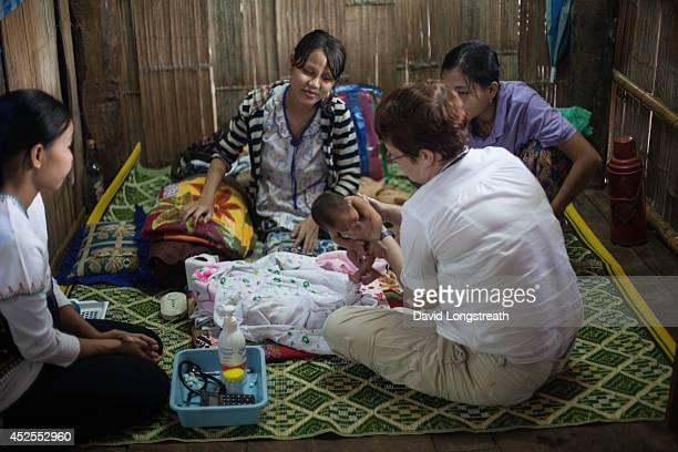 A doctor looks after ethnic Karen refugees in a border clinic Currently there are around 100000 refugees living in Thailands nine refugee camps in...